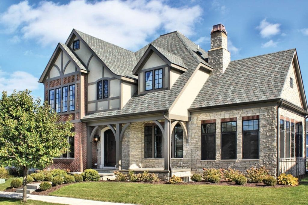 tudor home with fond du lac neutral colored stone veneer on exterior