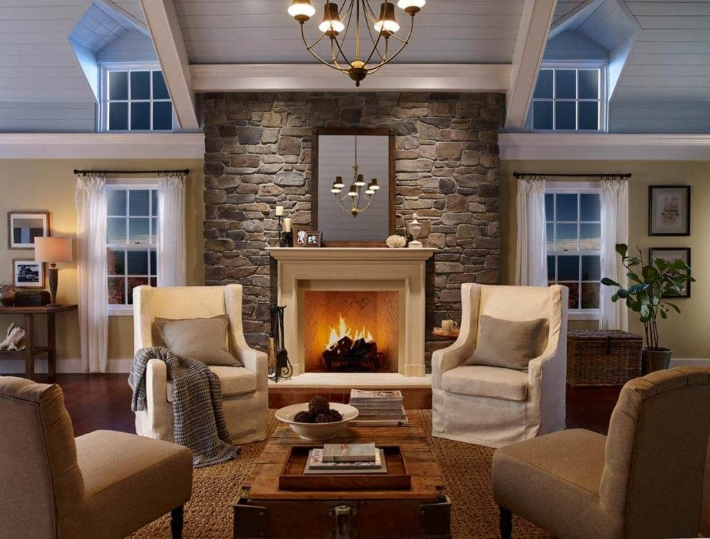 traditional living room with prominent cast stone fireplace and manufactured stone wall