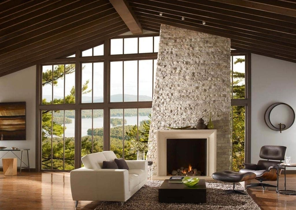 modern living room with a massive stone fireplace and cast stone surround